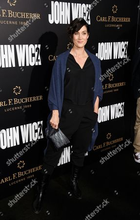 """Stock Picture of Actress Carrie-Ann Moss poses at the premiere of the film """"John Wick: Chapter 2,"""" at ArcLight Cinemas, in Los Angeles"""