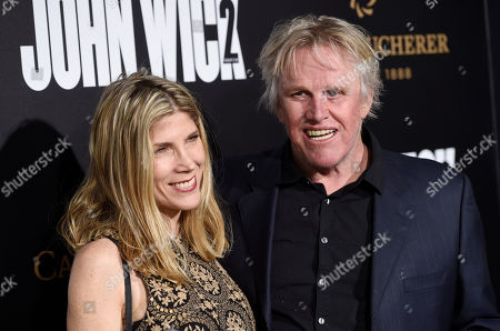 """Actor Gary Busey and Steffanie Sampson pose together at the premiere of the film """"John Wick: Chapter 2,"""" at ArcLight Cinemas, in Los Angeles"""