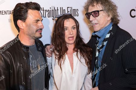 """Brad Wilk, from left, Juliette Lewis, and Mick Rock arrive at the LA Premiere of """"SHOT! The Psycho-Spiritual Mantra of Rock"""" at the Pacific Theatres at The Grove, in Los Angeles"""