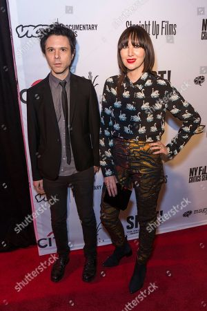 """Nick Zinner, left, and Karen O arrive at the LA Premiere of """"SHOT! The Psycho-Spiritual Mantra of Rock"""" at the Pacific Theatres at The Grove, in Los Angeles"""