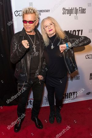 """Billy Idol, left, and Penelope Spheeris arrive at the LA Premiere of """"SHOT! The Psycho-Spiritual Mantra of Rock"""" at the Pacific Theatres at The Grove, in Los Angeles"""
