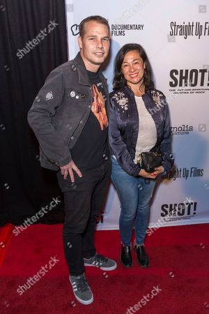 "Shepard Fairey, left, and Amanda Fairey arrive at the LA Premiere of ""SHOT! The Psycho-Spiritual Mantra of Rock"" at the Pacific Theatres at The Grove, in Los Angeles"