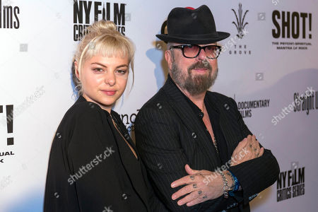 """David A. Stewart, right, and Kaya Stewart arrive at the LA Premiere of """"SHOT! The Psycho-Spiritual Mantra of Rock"""" at the Pacific Theatres at The Grove, in Los Angeles"""