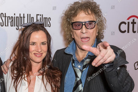 """Juliette Lewis, left, and Mick Rock arrive at the LA Premiere of """"SHOT! The Psycho-Spiritual Mantra of Rock"""" at the Pacific Theatres at The Grove, in Los Angeles"""