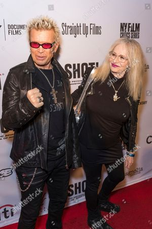 """Stock Image of Billy Idol, left, and Penelope Spheeris arrive at the LA Premiere of """"SHOT! The Psycho-Spiritual Mantra of Rock"""" at the Pacific Theatres at The Grove, in Los Angeles"""