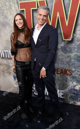 """Dana Ashbrook, a cast member in """"Twin Peaks,"""" poses with his wife Katie at the premiere of the Showtime series at The Theatre at Ace Hotel, in Los Angeles"""