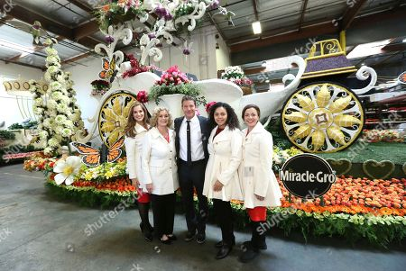 """Ty Pennington, center, Former Rose Queens royalty, Mary McCluggage, from left, Barbara Laughray Boyd, Madison Triplett and Aliya Coher seen at Miracle-Gro's """"Everythings Coming Up Roses"""" float entry in the 128th Rose Parade. Float judging took place at Fiesta Parade Floats, in Irwindale, Calif"""