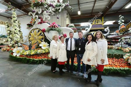 """Barbara Laughray Boyd, from left, Aliya Coher, Ty Pennington, John Sass, Madison Triplett and Mary McCluggage seen at Miracle-Gro's """"Everythings Coming Up Roses"""" float entry in the 128th Rose Parade. Float judging took place at Fiesta Parade Floats, in Irwindale, Calif"""