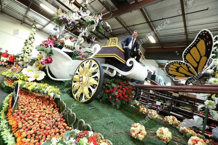 """Ty Pennington, right, and Former Rose Queens royalty, Barbara Laughray Boyd and Aliya Coher seen at Miracle-Gro's """"Everythings Coming Up Roses"""" float entry in the 128th Rose Parade. Float judging took place at Fiesta Parade Floats, in Irwindale, Calif"""