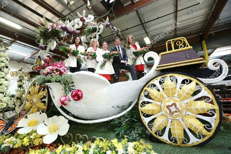 """Ty Pennington, second from right, Former Rose Queens royalty, Madison Triplett, from left, Barbara Laughray Boyd, Aliya Coher and Mary McCluggage seen at Miracle-Gro's """"Everythings Coming Up Roses"""" float entry in the 128th Rose Parade. Float judging took place at Fiesta Parade Floats, in Irwindale, Calif"""