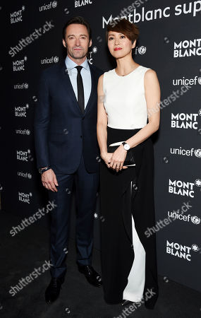 Stock Picture of Hugh Jackman, left, and Gigi Leung attend the Montblanc for UNICEF Collection launch event at the New York Public Library, in New York