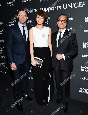 Hugh Jackman, left, Gigi Leung and Montblanc CEO Nicolas Baretzi attend the Montblanc for UNICEF Collection launch event at the New York Public Library, in New York
