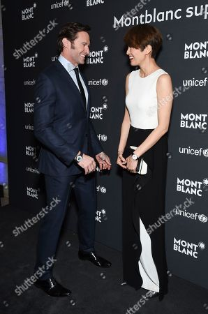 Hugh Jackman, left, and Gigi Leung attend the Montblanc for UNICEF Collection launch event at the New York Public Library, in New York
