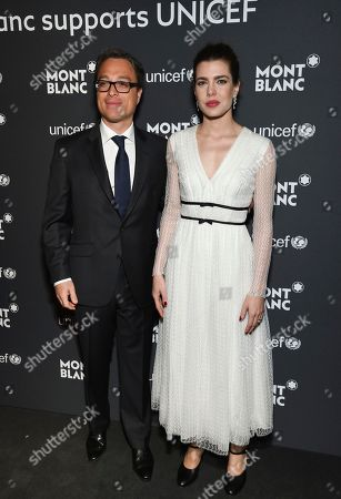 Montblanc CEO Nicolas Baretzki, left, and Princess Charlotte Casiraghi attend the Montblanc for UNICEF Collection launch event at the New York Public Library, in New York