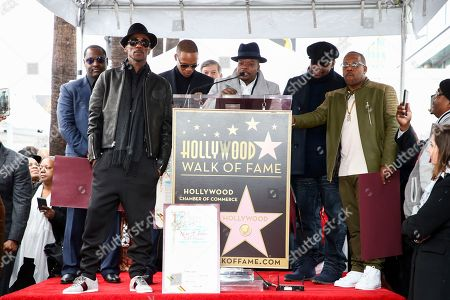 Johnny Gill, from left to right, Ralph Tresvant, Ronnie DeVoe, Ricky Bell, Bobby Brown and Michael Bivins attend a ceremony honoring New Edition with the 2,600th star on the Hollywood Walk of Fame, in Los Angeles