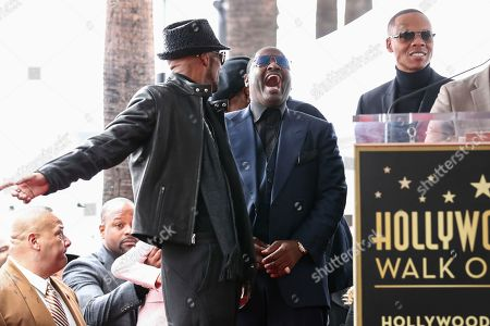 Ralph Tresvant, from left to right, Johnny Gill and Ronnie DeVoe attend a ceremony honoring New Edition with the 2,600th star on the Hollywood Walk of Fame, in Los Angeles