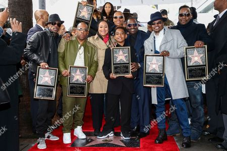 Ralph Tresvant, from left to right, Michael Bivins, Johnny Gill, Ronnie DeVoe, Bobby Brown and Ricky Bell attend a ceremony honoring New Edition with the 2,600th star on the Hollywood Walk of Fame, in Los Angeles
