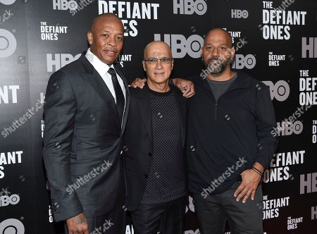 """Subjects of the film Dr. Dre, from left, and Jimmy Iovine pose with producer Allen Hughes at the premiere of HBO's """"The Defiant Ones"""" at the Time Warner Center, in New York"""