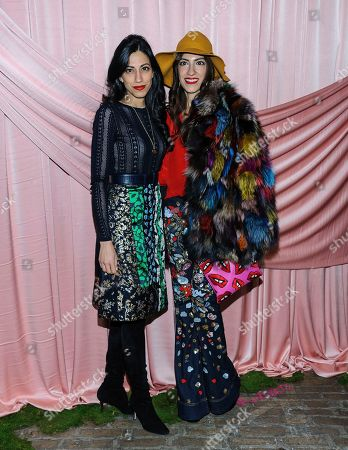 Huma Abedin, left, and Heba Abedin attend the Alice & Olivia show as part of NYFW Fall/Winter 2017 at Highline Stages, in New York