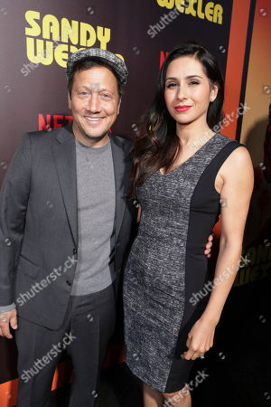 Stock Photo of Rob Schneider and Patricia Maya Schneider seen at Los Angeles Premiere of Netflix original film 'Sandy Wexler' at Arclight Hollywood, in Los Angeles, Ca