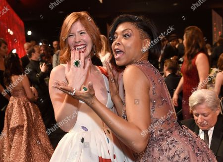 Trin Miller, left, and Taraji P. Henson appear in the audience at the 23rd annual Screen Actors Guild Awards at the Shrine Auditorium & Expo Hall, in Los Angeles