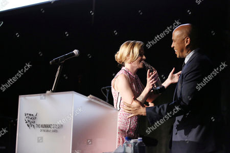 """Elizabeth Banks present the """"Humanitarian of the Year"""" award to Senator Cory Booker at The Humane Society of the United States' To The Rescue! Los Angeles Benefit at Paramount Studios, in Los Angeles. The event benefits The HSUS' Farm Animal Protection campaign and honors Sen. Cory Booker, D-NJ, and Christina Grimmie (posthumously) with performances by Noah Cyrus, Pharrell and Rachel Platten"""