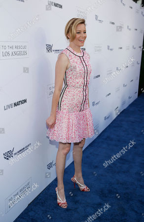 Elizabeth Banks walks the carpet at The Humane Society of the United States' To The Rescue! Los Angeles Benefit at Paramount Studios, in Los Angeles. The event benefits The HSUS' Farm Animal Protection campaign and honors Sen. Cory Booker, D-NJ, and Christina Grimmie (posthumously) with performances by Noah Cyrus, Pharrell and Rachel Platten