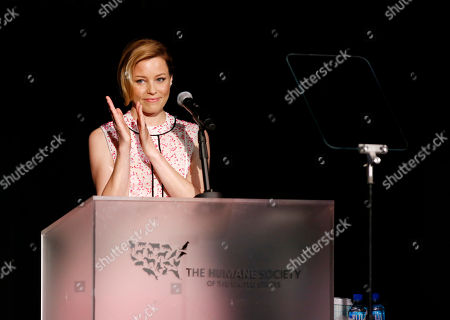 Stock Photo of Elizabeth Banks speaks at The Humane Society of the United States' To The Rescue! Los Angeles Benefit at Paramount Studios, in Los Angeles. The event benefits The HSUS' Farm Animal Protection campaign and honors Sen. Cory Booker, D-NJ, and Christina Grimmie (posthumously) with performances by Noah Cyrus, Pharrell and Rachel Platten