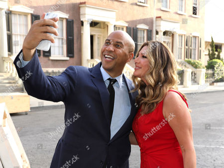 Senator Cory Booker, left, and Daisy Fuentes take a selfie at The Humane Society of the United States' To The Rescue! Los Angeles Benefit at Paramount Studios, in Los Angeles. The event benefits The HSUS' Farm Animal Protection campaign and honors Sen. Cory Booker, D-NJ, and Christina Grimmie (posthumously) with performances by Noah Cyrus, Pharrell and Rachel Platten
