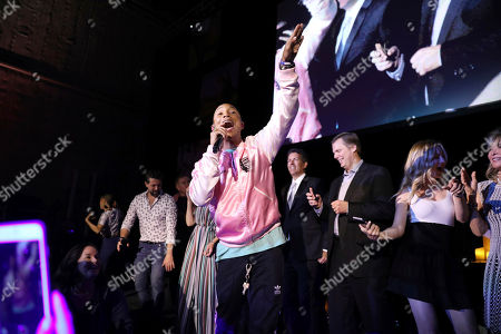 Stock Picture of Pharrell Williams is joined on stage during his performance by supporters of The Humane Society of the United States during is impromptu fundraising efforts at The HSUS' To The Rescue! Los Angeles Benefit at Paramount Studios, in Los Angeles. The event benefits The HSUS' Farm Animal Protection campaign and honors Sen. Cory Booker, D-NJ, and Christina Grimmie (posthumously) with performances by Noah Cyrus, Pharrell and Rachel Platten