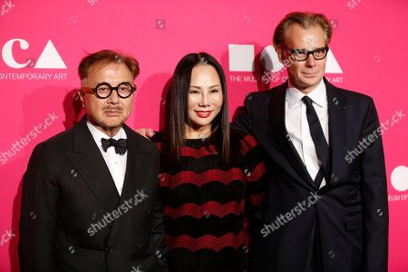 Michael Chow, left, Eva Chow, center, and MOCA Director Philippe Vergne, right, pose at The Museum Of Contemporary Art 2017 Annual Gala at The Geffen Contemporary at MOCA, in Los Angeles, Calif