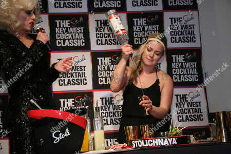 Stock Photo of Singer and comedic drag performer, Sherry Vine, looks on as Kayla Hasbrook competes in the 2017 New York Regional Stoli Key West Cocktail Classic Champion at Boxers Chelsea in New York City on