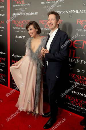 """Milla Jovovich and Director/Writer/Producer Paul W. S. Anderson seen at The World Premiere of Screen Gems' """"Resident Evil: The Final Chapter"""" at Regal LA Live, in Los Angeles"""