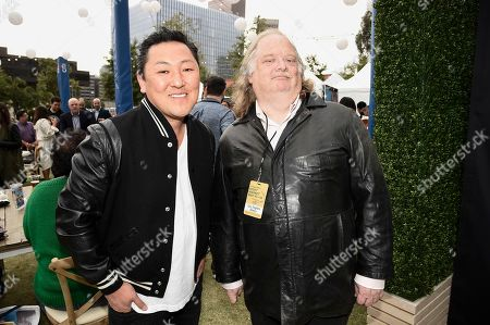 Stock Photo of Los Angeles Times Food Critic Jonathan Gold, right, and chef Sang Yoon at the Los Angeles Times Food Bowl Night Market at Grand Park LA, in Los Angeles