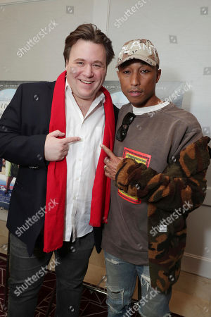 "Composer Ben Wallfisch and Producer/Composer Pharrell Williams seen at Twentieth Century Fox ""Hidden Figures"" Special Screening at the London West Hollywood on January, 04, 2017, in Los Angeles, CA"