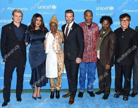 Stock Image of Orlando Bloom, left, Priyanka Chopra, Angelique Kidjo, David Beckham, Femi Kuti, Ishmael Beah and Jackie Chan attend UNICEF's 70th anniversary gala, at U.N. headquarters