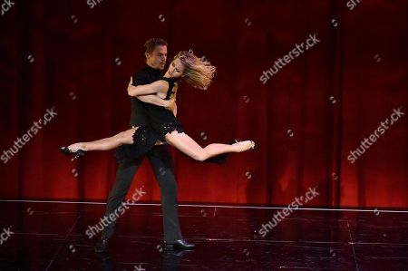"Stock Photo of Derek Hough, left and Ekaterina Fedosova perform at the Television Academy's ""Whose Dance Is It Anyway?"" event celebrating the art of choreography with an evening of dance created by renowned choreographers at the Saban Media Center on in the NoHo Arts District in Los Angeles"