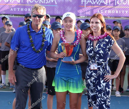 Stock Picture of Runner-up Su Jeong Jang poses with Ben Goldsmith, President, Tournament Director and Kyla Goldsmith, CEO, CFO on Center Court after the final of the WTA 125k Hawaii Open at Patsy T. Mink Central Oahu Regional Park in Waipahu, Hawaii - Michael Sullivan/CSMCenter