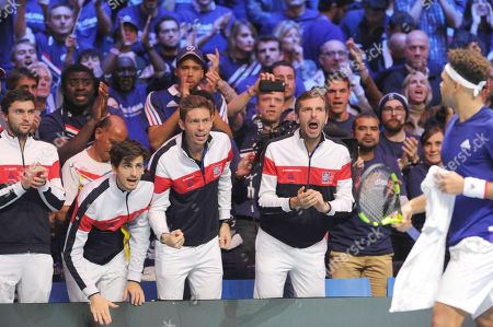 French Davis Cup team members Gilles Simon, Pierre Hugues Herbert, Nicolas Mahut, Julien Benneteau are cheering up French tennis player Jo-Wilfried Tsonga during his match in the Davis Cup Final vs Belgium tennis player David Goffin