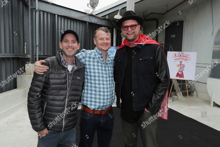 Stock Picture of Director David Soren, Producer Mark Swift and Soundtrack Producer Adam Anders seen at 'Captain Underpants: The First Epic Movie' Flag raising ceremony at the Capitol Records Building, in Los Angeles, CA