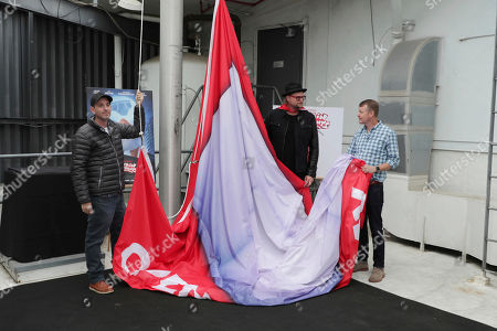 Stock Image of Director David Soren, Soundtrack Producer Adam Anders and Producer Mark Swift seen at 'Captain Underpants: The First Epic Movie' Flag raising ceremony at the Capitol Records Building, in Los Angeles, CA
