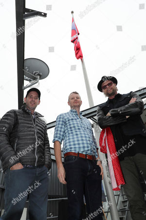 Stock Photo of Director David Soren, Producer Mark Swift and Soundtrack Producer Adam Anders seen at 'Captain Underpants: The First Epic Movie' Flag raising ceremony at the Capitol Records Building, in Los Angeles, CA