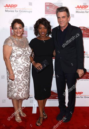 Jo Ann Jenkins, CEO of AARP, from left, Alfre Woodard and Roderick Spencer attend AARP's 16th Annual Movies for Grownups Awards at the Beverly Wilshire Hotel, in Beverly Hills, Calif