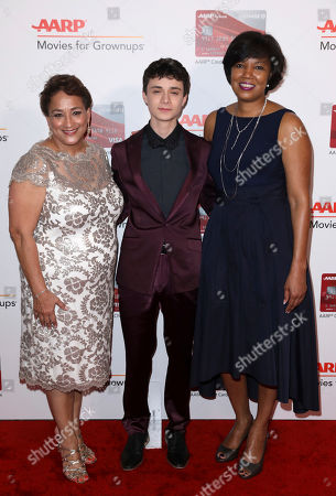 Jo Ann Jenkins, CEO of AARP, from left, Lucas Jade Zumann and Nichelle Evans, general manager, Travel & Affinity Partnership, CHASE Card Services, attend AARP's 16th Annual Movies for Grownups Awards at the Beverly Wilshire Hotel, in Beverly Hills, Calif