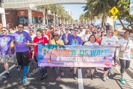 Lamman Rucker (far left), star of OWN Network's hit drama series Greenleaf, joins thousands of walkers on Fort Lauderdale Beach to walk in the 12th Annual Florida AIDS Walk & Music Festival presented by AIDS Healthcare Foundation and Wells Fargo, which raised over $1.4 million to support local HIV/AIDS services, in Fort Lauderdale, Fla
