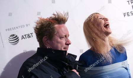 """Stock Image of John Lydon, known as Johnny Rotten, left, and Nora Forster attend a screening of """"The Public Image is Rotten"""" at the Spring Studios during the 2017 Tribeca Film Festival on in New York"""