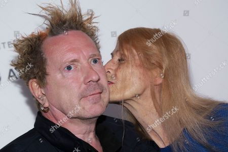 """John Lydon, known as Johnny Rotten, left, and Nora Forster attend a screening of """"The Public Image is Rotten"""" at the Spring Studios during the 2017 Tribeca Film Festival on in New York"""