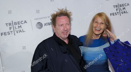 """Stock Photo of John Lydon, known as Johnny Rotten, left, and Nora Forster attend a screening of """"The Public Image is Rotten"""" at the Spring Studios during the 2017 Tribeca Film Festival on in New York"""