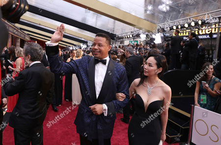 Terrence Howard, left, and Miranda Pak arrive at the Oscars, at the Dolby Theatre in Los Angeles