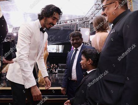 Dev Patel, left, and Sunny Pawar arrive at the Oscars, at the Dolby Theatre in Los Angeles